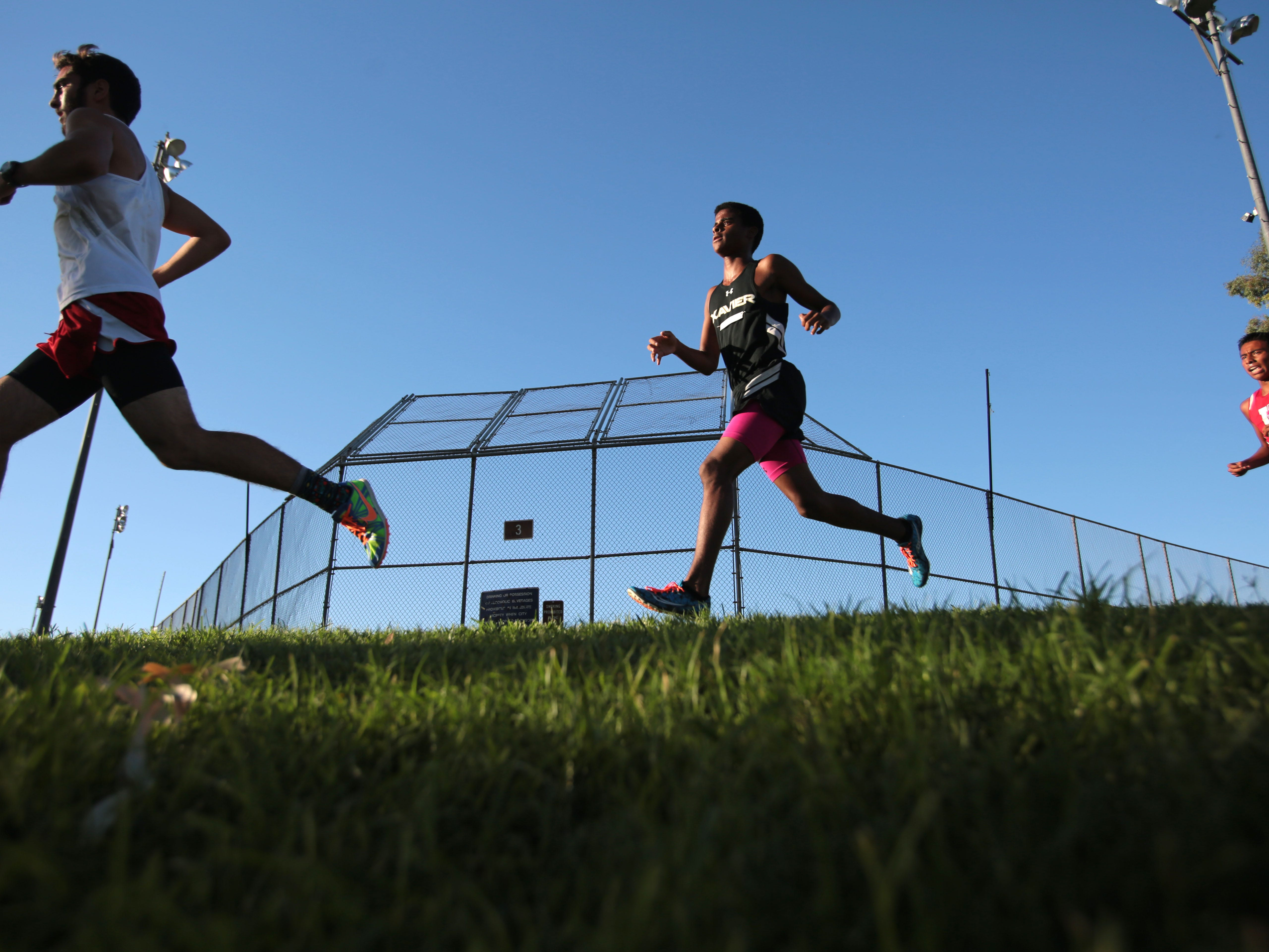 Runners race in the boys' varsity race during the DVL meet at Demuth Park in Palm Springs on Wednesday. Xavier Prep won the race.