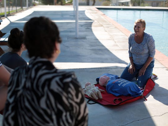 Rene Hickey, of Desert Hot Springs, gives a CPR demonstration during a event to raise awareness to re open the pool at Wardman Park in Desert Hot Springs, on Saturday, November 15, 2014.