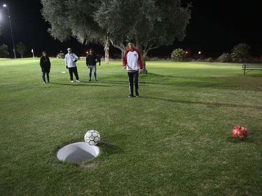 Gio Castillo watches his ball during a game of footgolf at Indio Golf Course.