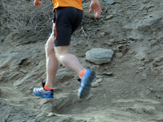 A runner can be seen heading up the Skyline Trail on Wednesday.