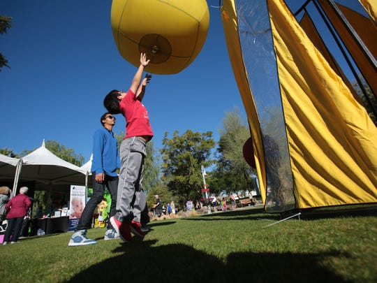 Josh Davis, 7, gets a workout tossing a large ball into a basket during the Humana Well-Being Walk and Healthy Fun Fair on Saturday, January 17, 2015 at Civic Center Park in La Quinta.