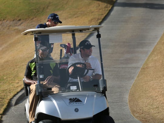2014 Human Challenge defending champion Patrick Reed, right, drives off the Nikolaus Private Course to go to a press conference on Tuesday, January 20, 2015 at PGA West in La Quinta.
