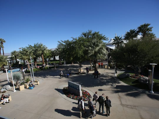 Palm Springs International Airport had a 9.3 percent increase in passenger use in 2014. In this photo, travelers are photographed entering departure gates.