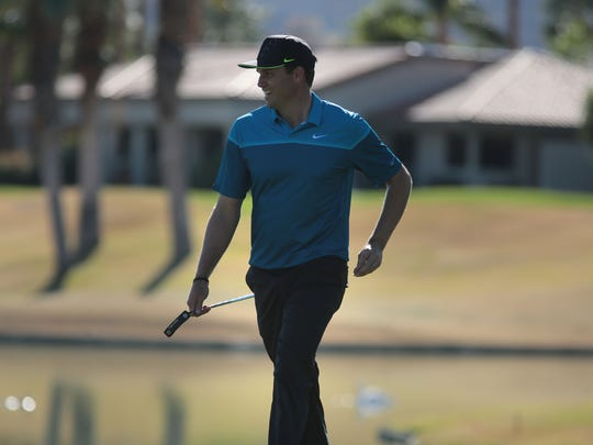 Nick Watney smiles as he approaches the 18th green on the Nicklaus Private Course at PGA West during the second round of the Humana Challenge on Friday. Watney shot an 8-under 64 and is tied for fourth.
