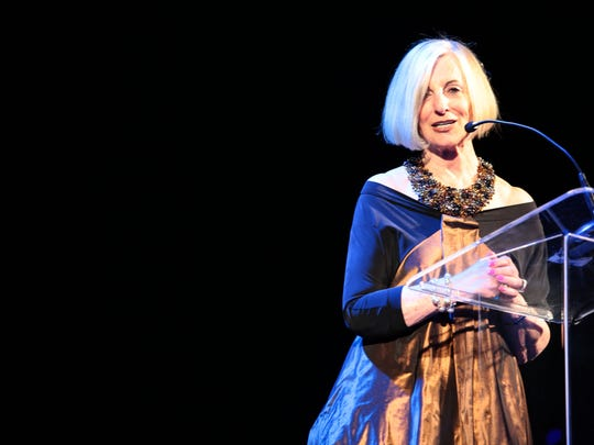 """Helene Galen acceps the """"100 Women Award"""" presented to her by U.S. Senator Barbara Boxer at the 21st annual Steve Chase Humanitarian Awards at the Palm Springs Convention Center Saturday night."""