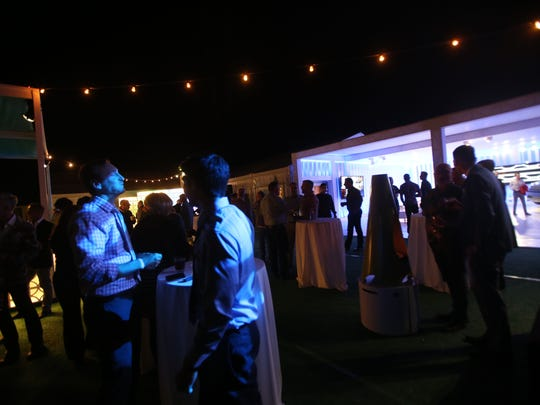 Guests enjoy Thursday's Modernism Week kick-off party.