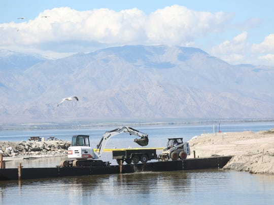 Heavy equipment is used to dredge at the Salton Sea in order to allow larger boats to enter the lake in this outlet, located at the Salton Sea State Recreation Area, on March 3, 2015.