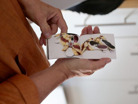 Shoe designer and maker Debra Hovel documents the with photos and creates a booklet that is presented with the finished pair.