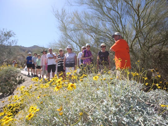 "Jess Rosenberg leads a ""nature walk"" at the Coachella Valley Wildflower festival held at the Santa Rosa and San Jacinto National Monument Visitor Center in Palm Desert in 2015. The government shutdown is forcing organizers to move this year's event to Civic Center Park on March 2, 2019."