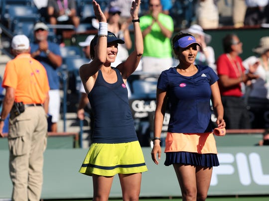 Martina Hingis, of Switzerland, and Sania Mirza, of India, after their 6-3, 6-4 win over the Russian pair of Elena Vesnina and Ekaterina Makanrova for this years BNP Paribas Open Women's Doubles title.