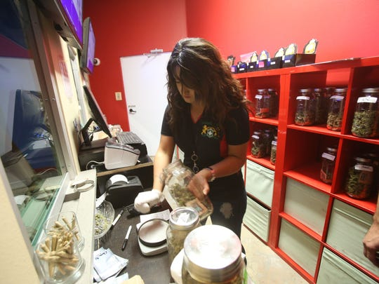 Sandra Avila, a supervisor at Sun Grow in Desert Hot Springs, prepares one gram of medical marijuana to be sold at the dispensary.