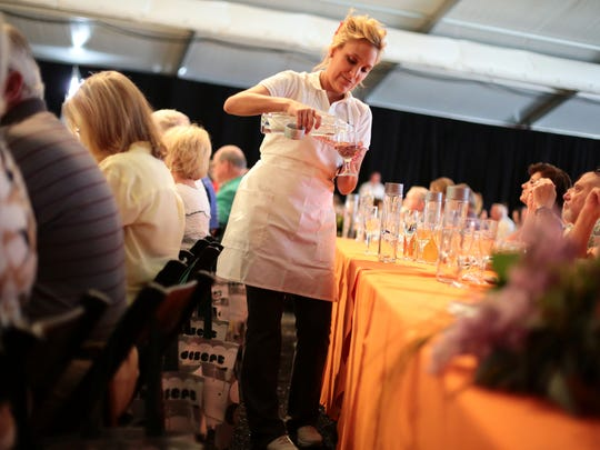 Volunteers serve guests at the James Beard Luncheon in Palm Desert on Friday.