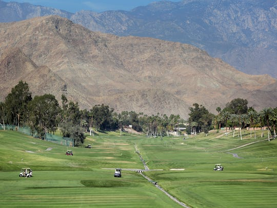 Golfers play at Rancho Las Palmas in Rancho Mirage on Thursday. The Coachella Valley features 123 golf courses, some of which use non-potable water.