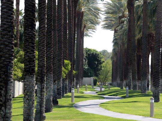 A sidewalk flanked by lush lawns run along HWY 111 in Indian Wells on Thursday. The city uses recycled water to irrigate its medians and other grassy areas.