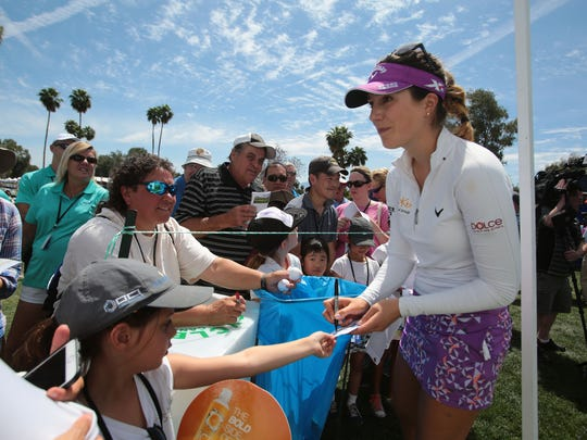 Sandra Gal sign autographs after the second round of the ANA Inspiration at Mission Hills Country Club in Rancho Mirage on Friday.