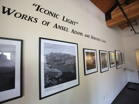 "The La Quinta Museum unveiled three new exhibits as part of the United Nation's designation of 2015 as the International Year of the Light and Light-Based Technologies. ""Nature's Beloved Son: Rediscovering John Muir's Botanical Legacy"" highlights his love of botany and traces his travels through North America. ""Iconic Light"" is a photo exhibit of the Coachella Valley in the 1930s, with rare photos by Ansel Adams and Dorothea Lange. The third exhibit is ""Poetry in Space: Hubble at 25,"" featuring images from the Hubble telescope. In this photo part of the John Muir exhibit is photographed."