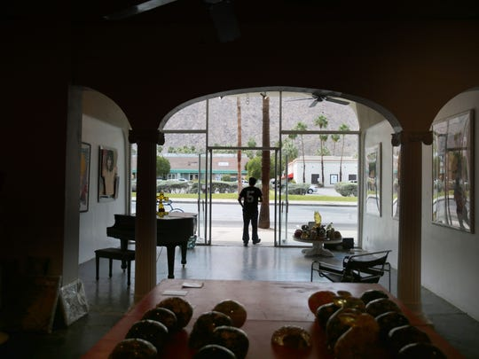 Dimitri Halides, the owner of Gallery 446 in Palm Springs, is among those having to find a new business location.