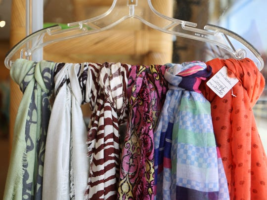 Scarves are among the final items up for sale at Dani C, which is closing.