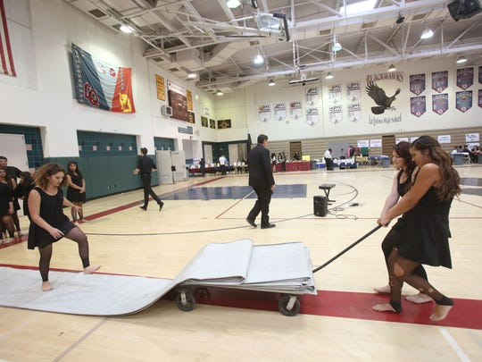 """Indio High School Winter Guard participates in the 14th Annual """"Brigade Blast"""" on Saturday, April 25, 2015 at the La Quinta High School Gym. The 2015 Brigade Blast fundraiser featured bands from Cathedral High School, Palm Desert High School, Shadow Hills High School and the La Quinta High School."""