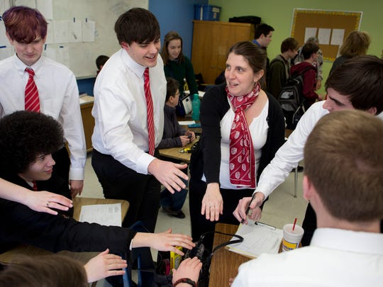 Port Huron varsity coach Kelly Harrington hypes up her team before a round against Imlay City during 30th annual Blue Water Quiz Bowl tournament at Port Huron Northern High School.