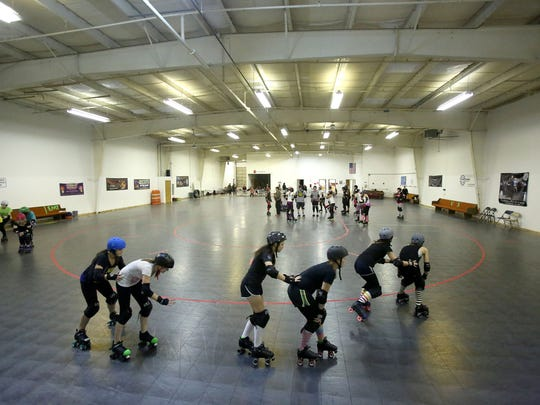 Members of the Cherry Blossoms Jr Derby league practice on Tuesday Nov. 18, 2014 in Salem, Ore.