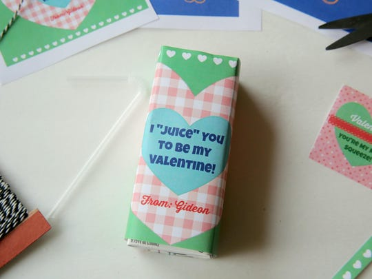 """These juice boxes are labeled with custom printables that feature the cute slogan """"I 'juice' you to be my Valentine."""""""