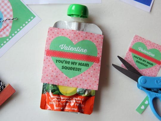 """Dress up an applesauce pouch for Valentine's Day with a cute printable tag that says """"Valentine, You're My Main Squeeze."""""""