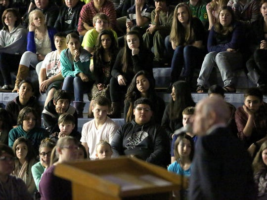 Alter Wiener, Holocaust survivor, speaks at Crossler Middle School on Friday, Feb. 13, 2015, in Salem, Ore. More than 700 students attended the discussion as he shared the story of his life after the German invasion of Poland in 1939.