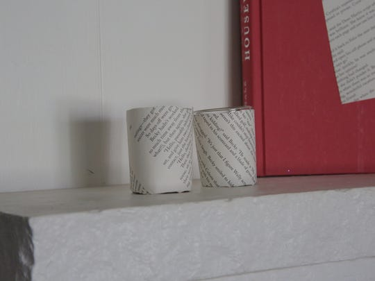 Turn a pair of glass votive candles into literary illumination.