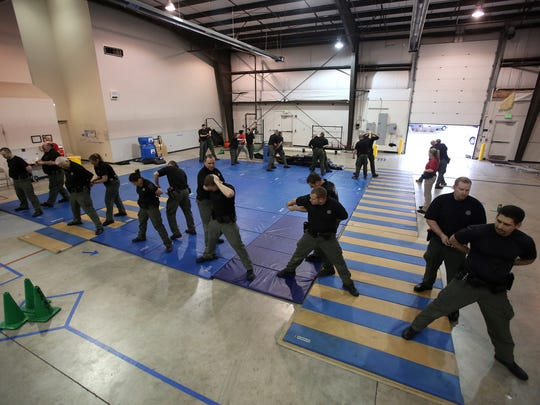 Members of the Marion County Sheriff's Office learn defensive tactics