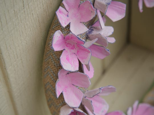 This wreath made out of recycled egg cartons is inspired by the pale pink blossoms of the cherry tree.