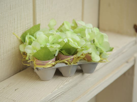 Recycle an egg carton into a cute hydrangea and Easter egg centerpiece. This sweet egg carton flower centerpiece is pretty enough to display all spring. If you have a green thumb, try planting live plants in the eggs instead.