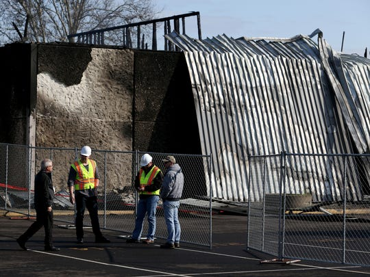 Investigators work at the scene of a cafeteria fire at South Albany High School on Thursday.