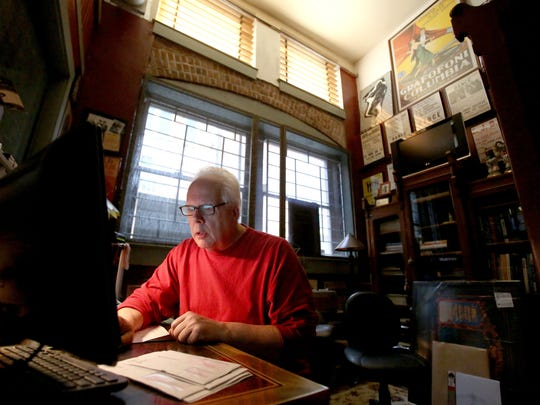 Kit Close, who owns Ranch Records with his wife, Lori, works in his office at the store. The business will be participating in Record Store Day on April 18, offering specially released records for the occasion.