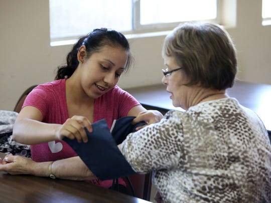 Ana Rios takes Alice Taylor's blood pressure at the Mid-Valley Literacy Center in Keizer, on Thursday, April 15, 2015. Taylor is a retired nurse who volunteers to help people with pre CNA classes at the center.