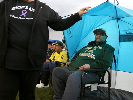 Pancho Tavera, a longtime youth baseball coach and assistant high school coach, watches his son play on McKay's baseball team April 7 in Salem. Tavera died Monday, April 20.