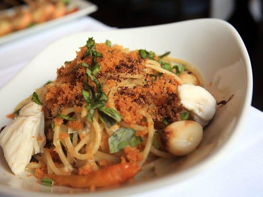 Spaghetti Bottarga with crabmeat, chilies and white