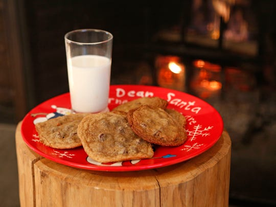 Cookies for the young: Classic chocolate chip cookies and milk are photographed Nov. 18, 2014 in Ridgefield, Conn.