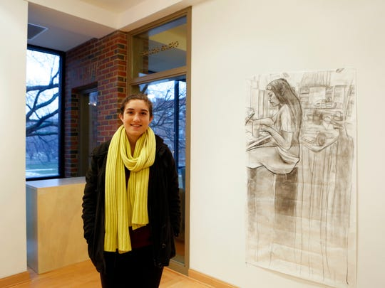 """Scarsdale High School's Maggie O'Keffe, 17, with her work titled """"A Classroom Concentration"""" at OSilas Gallery in Concordia College on Jan. 12 in Bronxville. Students dropped off their work to be hung for the StART 2015 Regional High School Art Exhibition."""