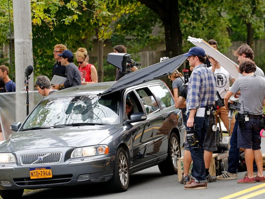 "A production crew shoots ""Louder Than Bombs,"" a movie with Gabriel Byrne and Jesse Eisenberg, at Franklin Street Park in Nyack last year."