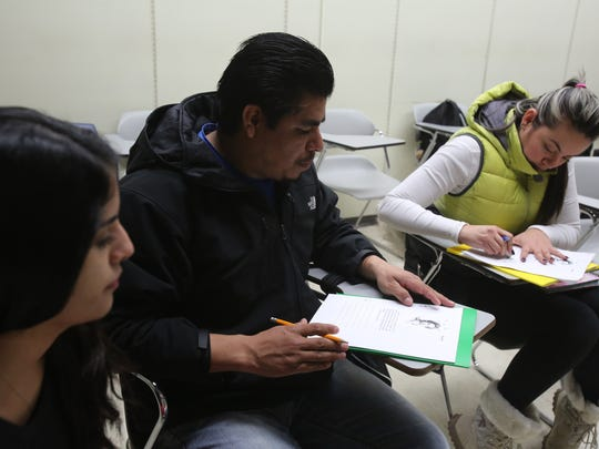 Senior Purchase student Lauren Pinet, left, helps Ismel Cervantes, center, and Alejandra Lopez with writing and reading in English Feb. 12 at Purchase College.