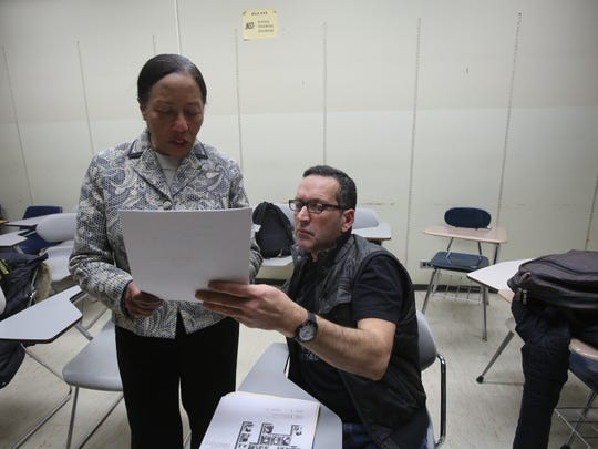 Joan Meade, the ESL coordinator, left, helps participant Juan Bedoya with writing and reading in English during class at Purchase College Feb. 12, 2015. The university teaches English to non native speakers during a night class called Casa Purchase.