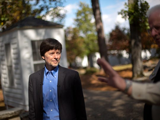 Documentary filmmaker Ken Burns walks through the entrance of the Georgia home used by former President Franklin D. Roosevelt during a tour by site manager Robin Glass in Warm Springs, Georgia.