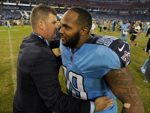 Titans General Manager Jon Robinson hugs Titans defensive