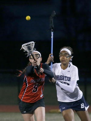 Penfield's Beth Lawatsch and Brighton's Piper Davis battle for the ball in the first half.