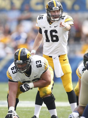 Iowa Hawkeyes quarterback C.J. Beathard (16) gestures while under center Austin Blythe (63) against the Pittsburgh Panthers during the third quarter at Heinz Field. The Hawkeyes won 24-20.