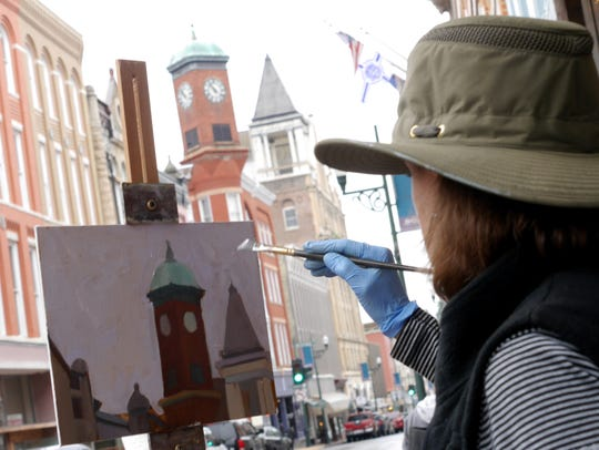 Meg Walsh of Easton, Maryland paints the Clock Tower
