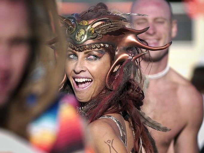 Wendy Doyle, of Los Angeles, smiles as she dances at the Burning Man festival, Thursday, Aug. 31, 2006, in the Black Rock Desert near Gerlach, Nev.