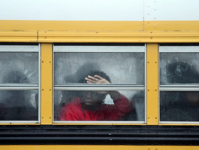 A N.R. Burger Middle School student looks out the window