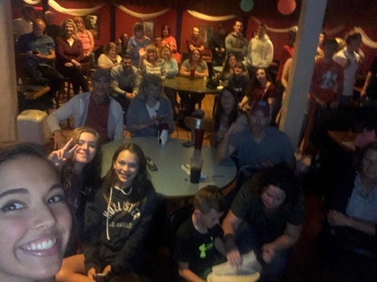 """The Voice"" watch party Monday night, at El Azteco West (downstairs). ""The Voice"" contestant Rebecca Brunner is in bottom left corner."